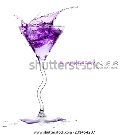 Stemmed cocktail glass with blackberry liquor splashing out, close-up isolated on white, with sample text. Template design. Party concept - stock photo