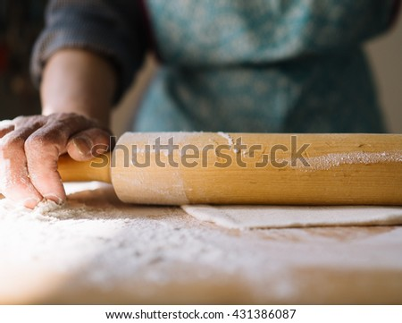 Step by step process of making home-made dumplings or pelmeni with minced meat filling using ravioli mold or maker. Flatten dough with rolling pin - stock photo
