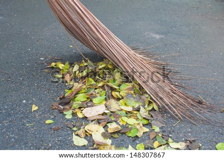 step clean , dry leaves , broom , swab - stock photo