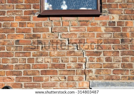 step cracking to a brick wall caused by subsidence  - stock photo