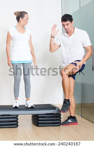 Step exercise with physical therapist  - stock photo