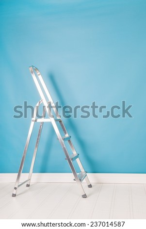 step ladder in blue interior - stock photo