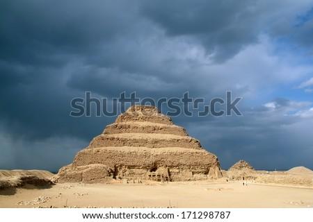 Step pyramid in Saqqara against dramatic stormy sky, Egypt - stock photo