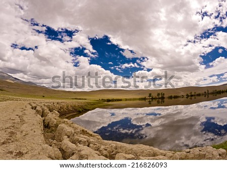 Steppe semi desert landscape of altai mountains (russia): dry clay