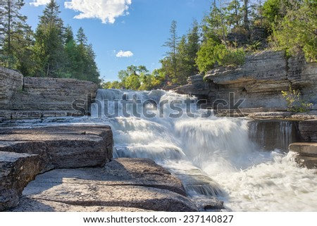 stepped rapids on the Bonnechere River near Eganville Ontario Canada - stock photo