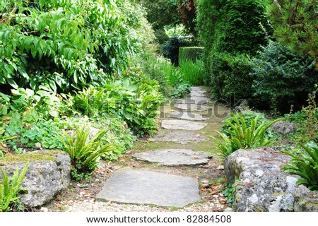 Stepping Stone Path in a Peaceful Green Garden - Low Angle View with a Shallow Depth of Field - stock photo