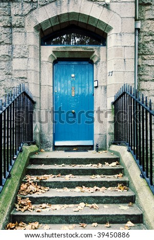 Steps leading up to a door - stock photo