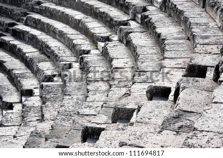 Steps of an ancient amphitheater - stock photo