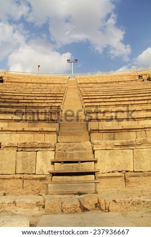 Steps of the Amphitheater ruins in Caesarea Maritima National Park, a city and harbor built by Herod the Great about 25-13 BC. The archaeological ruins are on the Mediterranean coast of Israel. - stock photo