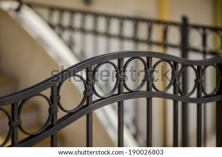 steps of the house, detail of wrought iron railing with beautiful ornaments - stock photo