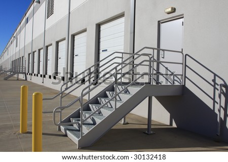 Steps on warehouse loading dock - stock photo