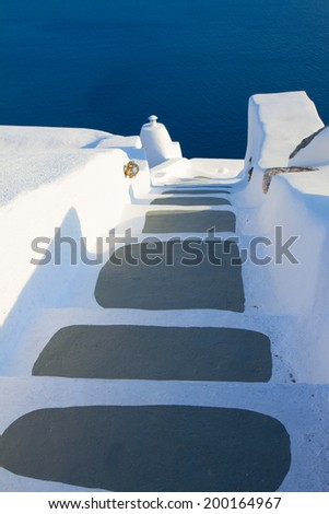 steps to blue sea waters, beautiful details of Santorini island, Greece - stock photo