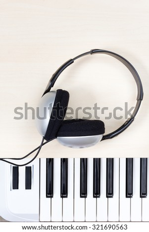 stereo headphone on piano / keyboards / synthesizer for music background - stock photo