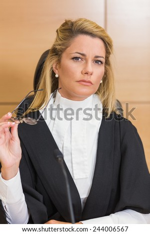 Stern judge looking away in the court room - stock photo