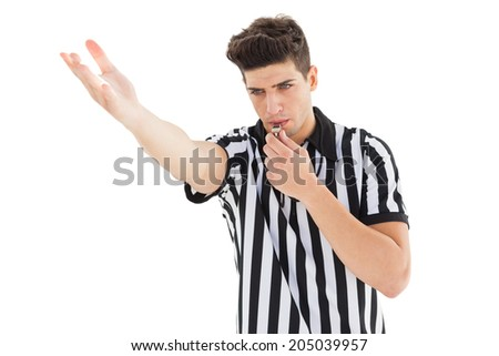Stern referee blowing his whistle on white background - stock photo