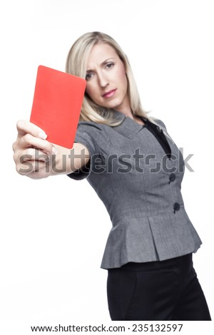 Stern young woman or referee in a stylish grey top showing a red card to send a player off the field or out of the game, isolated on white - stock photo