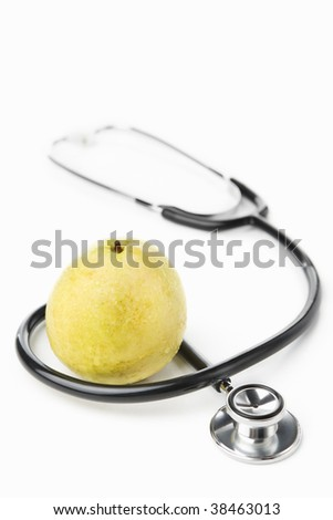 Stethoscope and a guava over white for health lifestyle concept - stock photo