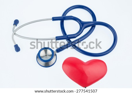 stethoscope and a heart symbol photo for cardiovascular risk and heart attack - stock photo