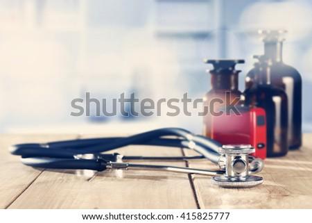 stethoscope and desk  - stock photo