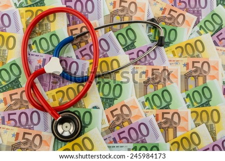 stethoscope and euro banknotes. photo icon for health care costs and health insurance for medical and - stock photo