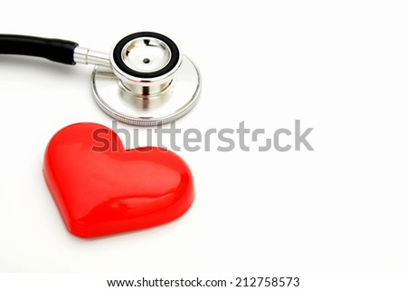 Stethoscope and heart toy - stock photo