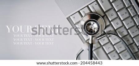 Stethoscope and Keyboard - stock photo