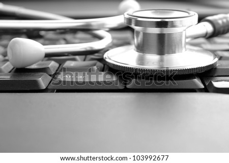 stethoscope and keyboard, as well as a place for your text - stock photo