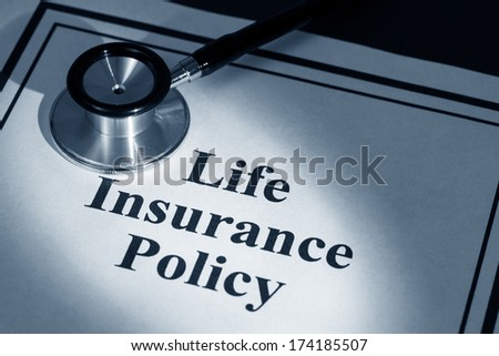 stethoscope and life insurance policy,  - stock photo