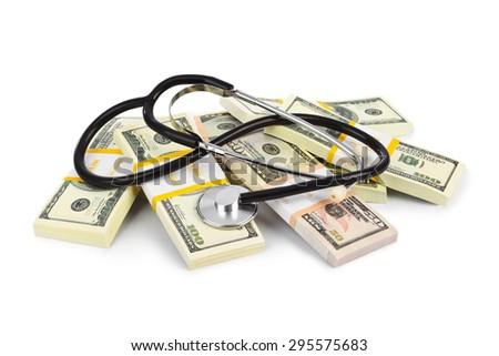 Stethoscope and money isolated on white background - stock photo