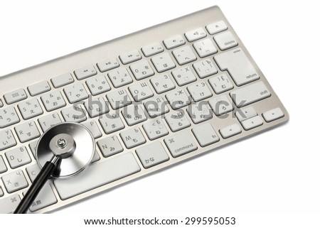 Stethoscope And Multilingual  Wireless Keyboard Isolated On White Background. Technical Support Or Repair Service Or Data Storage Or Information Security Concept - stock photo
