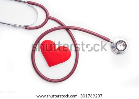 Stethoscope and red heart on white background. - stock photo