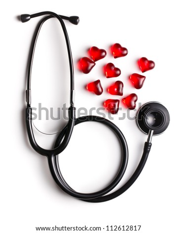 stethoscope and red hearts on white background - stock photo