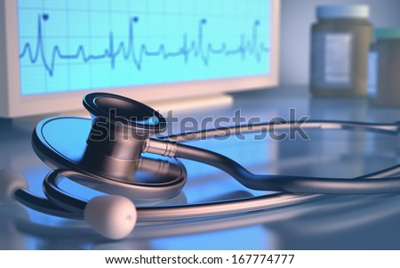 Stethoscope in front of the heartbeat monitor. - stock photo