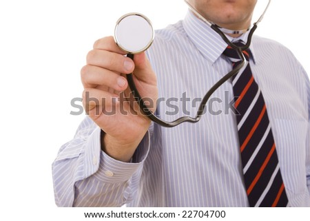 stethoscope in the doctor hand pointing to you (selective focus) - stock photo
