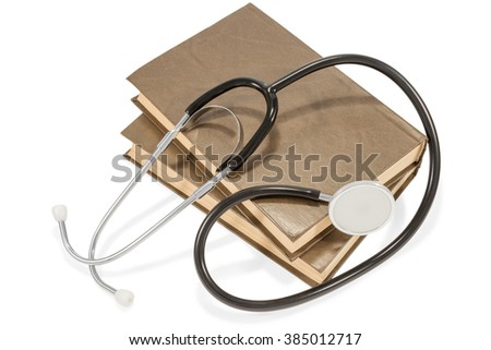 Stethoscope lying on a stack of two brown books isolated on white background - stock photo