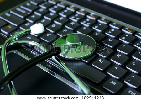 Stethoscope on a laptop computer - stock photo