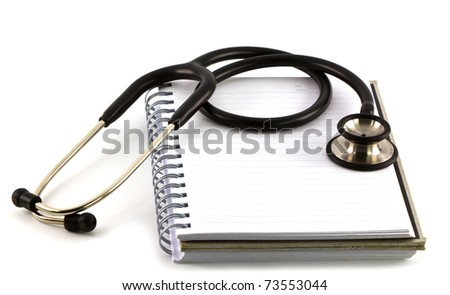 stethoscope on a pile of books - stock photo