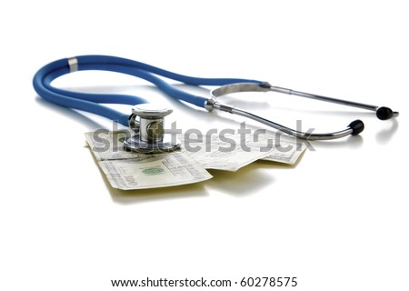 "Stethoscope on american money, represents concepts of  ""Financial Check Up"", High Cost of ""health care"", High Cost of ""Health Insurance"" and more - stock photo"