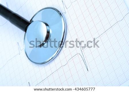 Stethoscope on chart heartbeat background - stock photo
