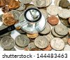 stethoscope on currency coin for financial examination healthy concept - stock photo