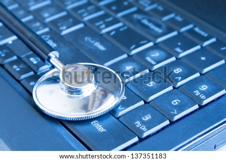 Stethoscope on keyboard (computer, laptop) close up. Medical education and information concept. - stock photo