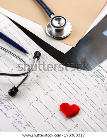 Stethoscope on medical billing statement on table - stock photo