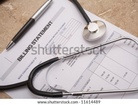 Stethoscope on medical billing statement on table, all text is anonymous - stock photo