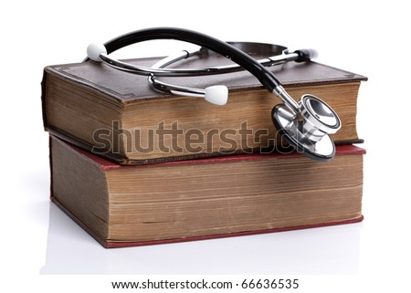 Stethoscope on old hardback books concept for medical research or ethic - stock photo