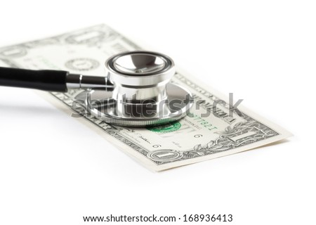 stethoscope on one dollar under white background, cost of medical health care - stock photo