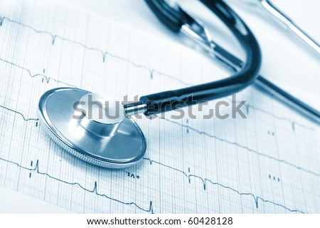 stethoscope on the cardiogram - stock photo