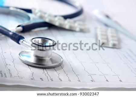 stethoscope on the cardiogram - stock photo