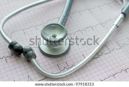 stethoscope on the ECG. Symbolic close-up photo - stock photo