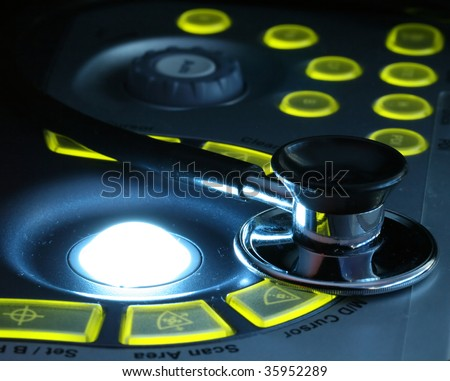 stethoscope on the ultrasound machines control panel - stock photo