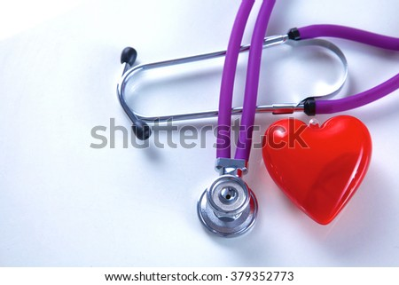 Stethoscope on white table with shallow depth of field for medical college concept - stock photo